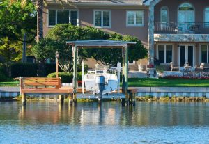 Boat lift by a lake house